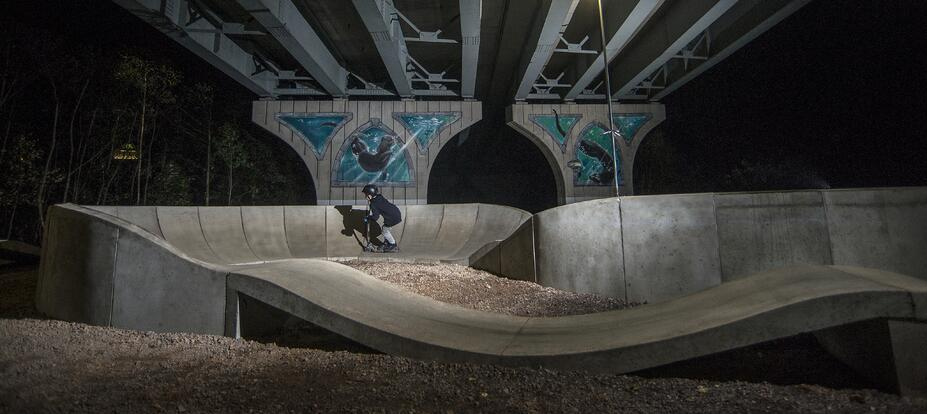 """A PARKITECT modular pumptrack breathes life into a so called """"dead-space,"""" like under bridges in New Bridge, UK."""
