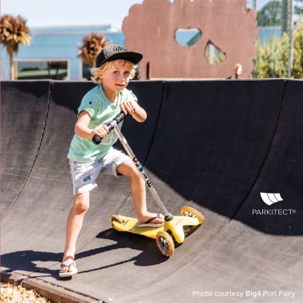 All ages, all abilities. Boy rides a PARKITECT modular pumptrack at Big4 Port Fairy in Victoria, Australia.