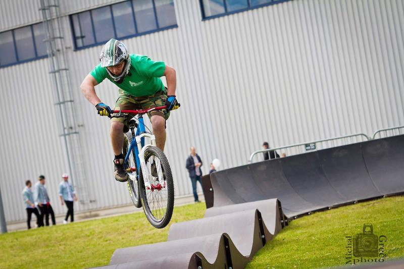 All ages, all abilities. Pro-rider male rides a PARKITECT modular pumptrack.