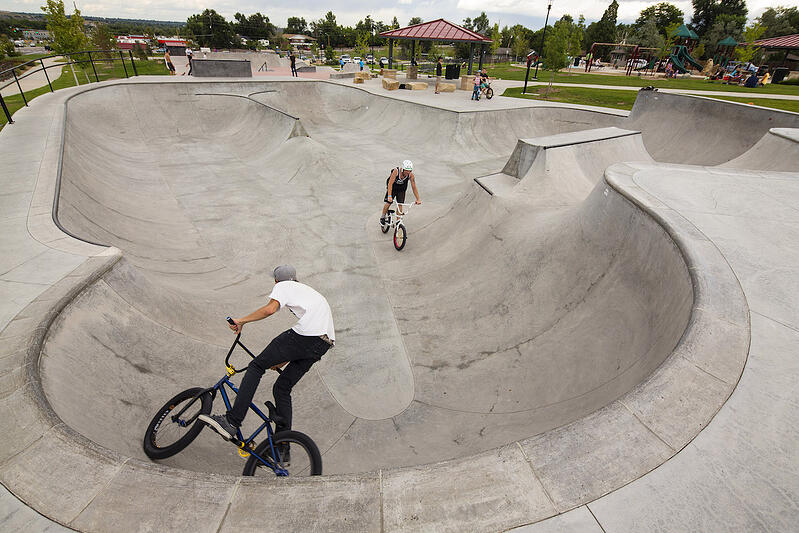 A skate park is an attraction for older youth at Discovery Park's multigenerational playground.