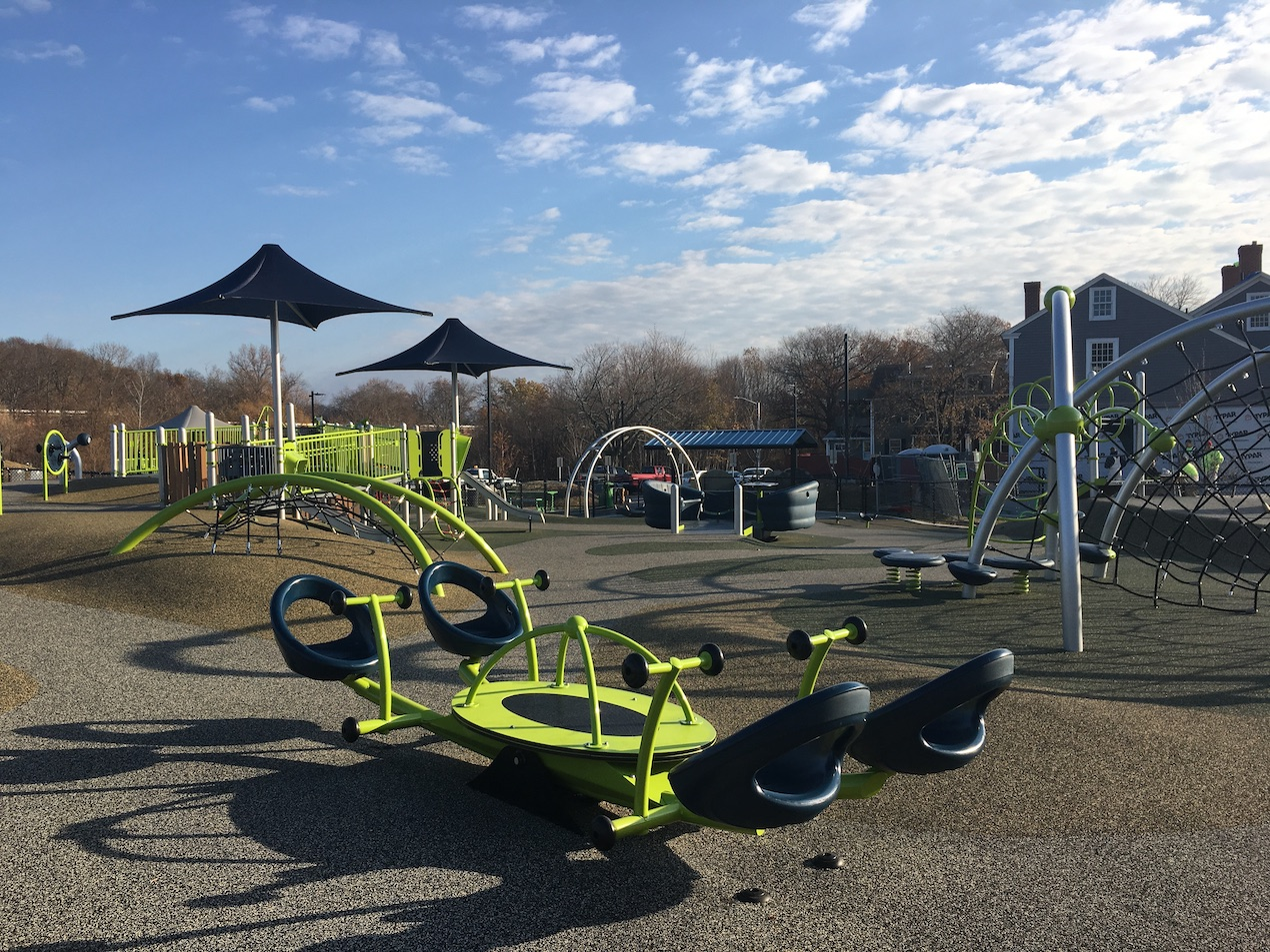 The equipment at a multigenerational and accessible playground in Coes Pond Park in Worchester, MA.