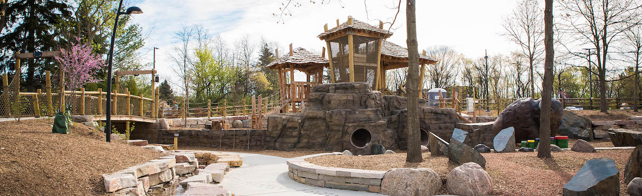 Bisons Bluff Park is a natural playground in Schaumburg, Illinois. The playground includes logs, boulders, sand, water and manufactured components that resemble natural elements.