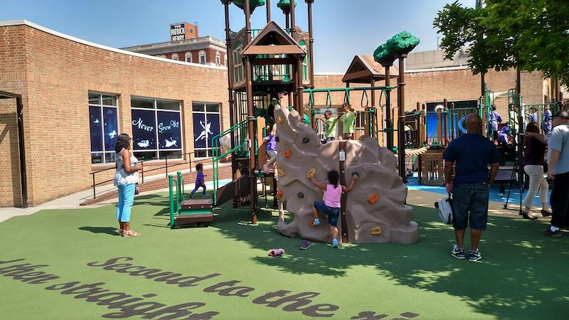 Children play at a playground inspired by Peter Pan at Elmwood Park, a themed playground installed by the City of Roanoke, Virginia.