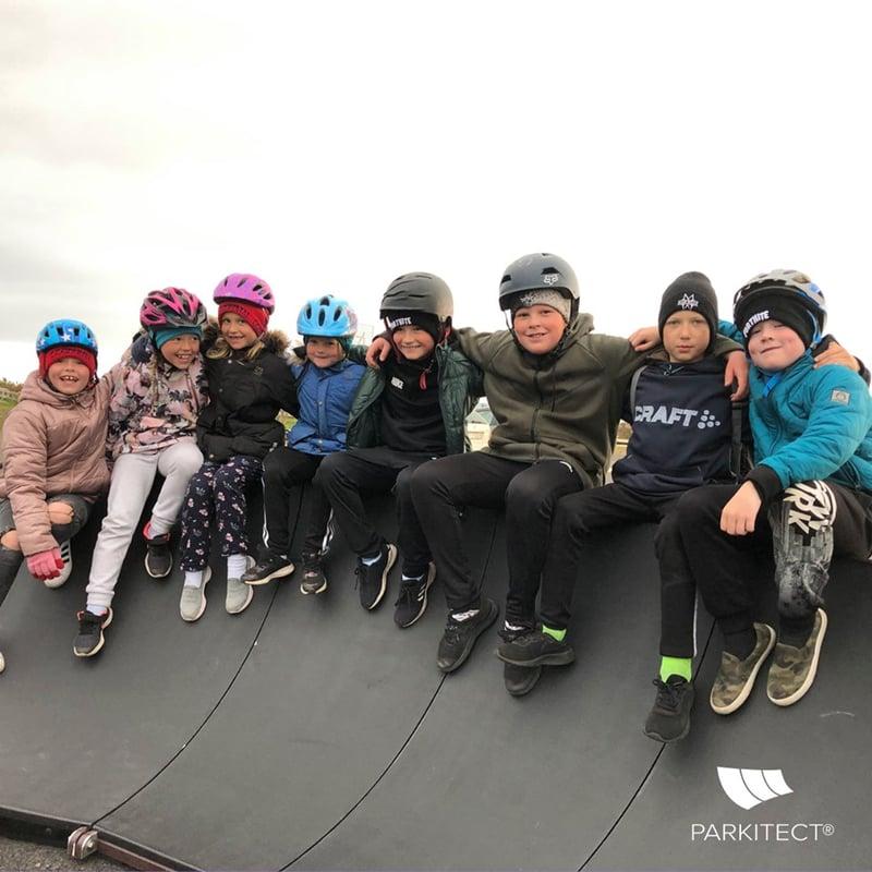 Kids smile sitting on PARKITECT modular pumptrack in Iceland