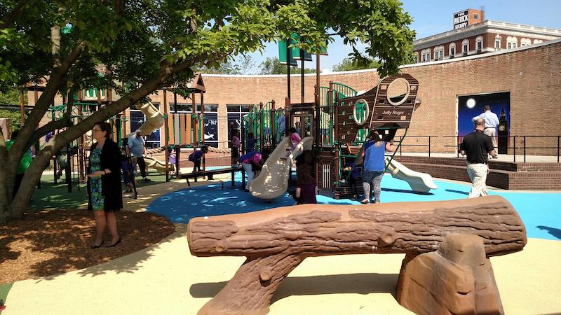 Never grow up. Children play on a themed playground based off of the children's classic book Peter Pan in Elmwood Park, Roanoke, Virginia. The playground includes a ship, rope bridge, the Lost Boys' treehouse and treasure maps highlighting local amenities in Roanoke.
