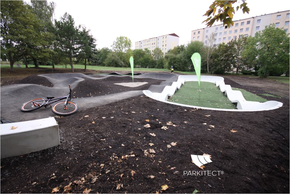 PARKITECT modular pumptrack made of precast concrete, incorporated in the landscape in