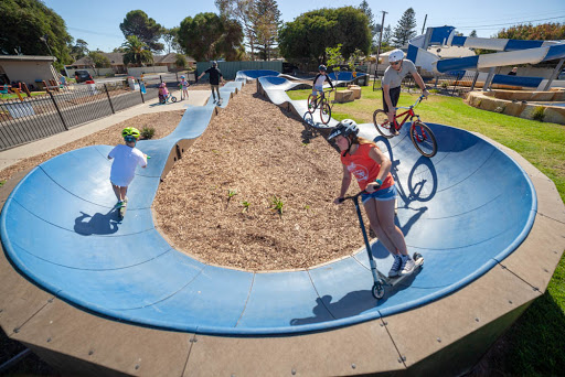 PARKITECTs modular pumptrack product photo with kids riding.