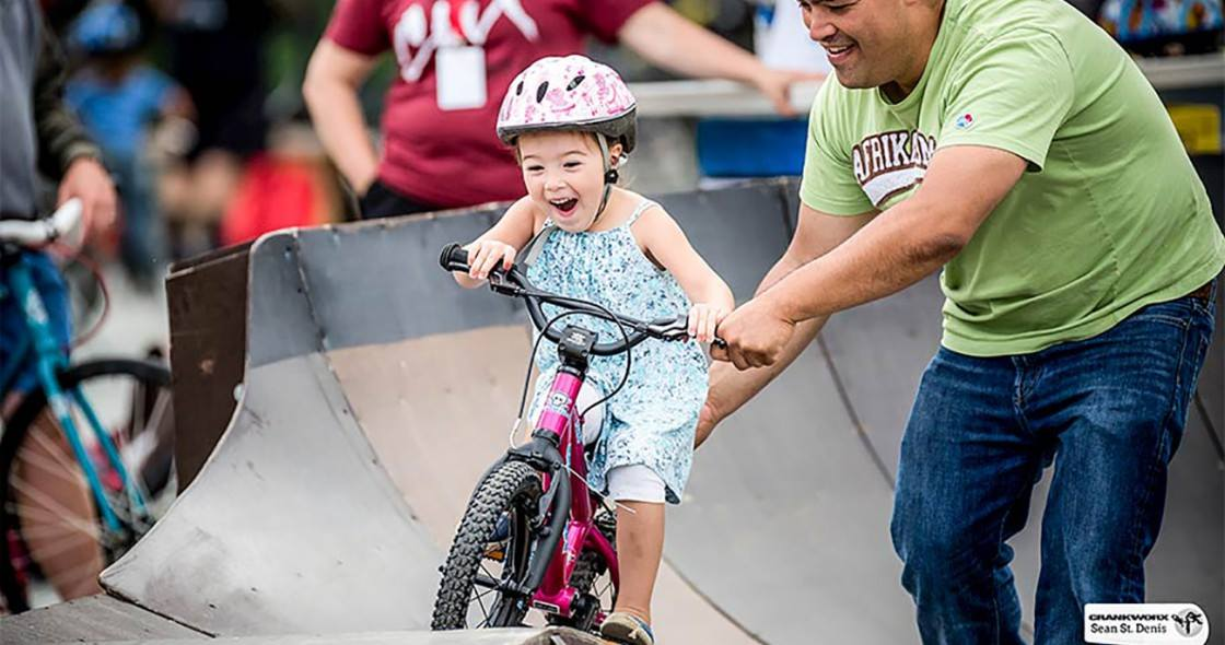Young-happy-girl-riding-bike-on-a-pumptrack